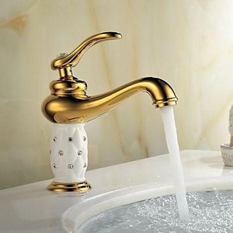 Baño antiguo con acabado en cristal dorado