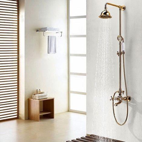 Columna de ducha tradicional en acabado dorado con forma de campana