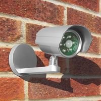 Dummy CCTV Camera Uni-Com with Flashing Light Battery Powered