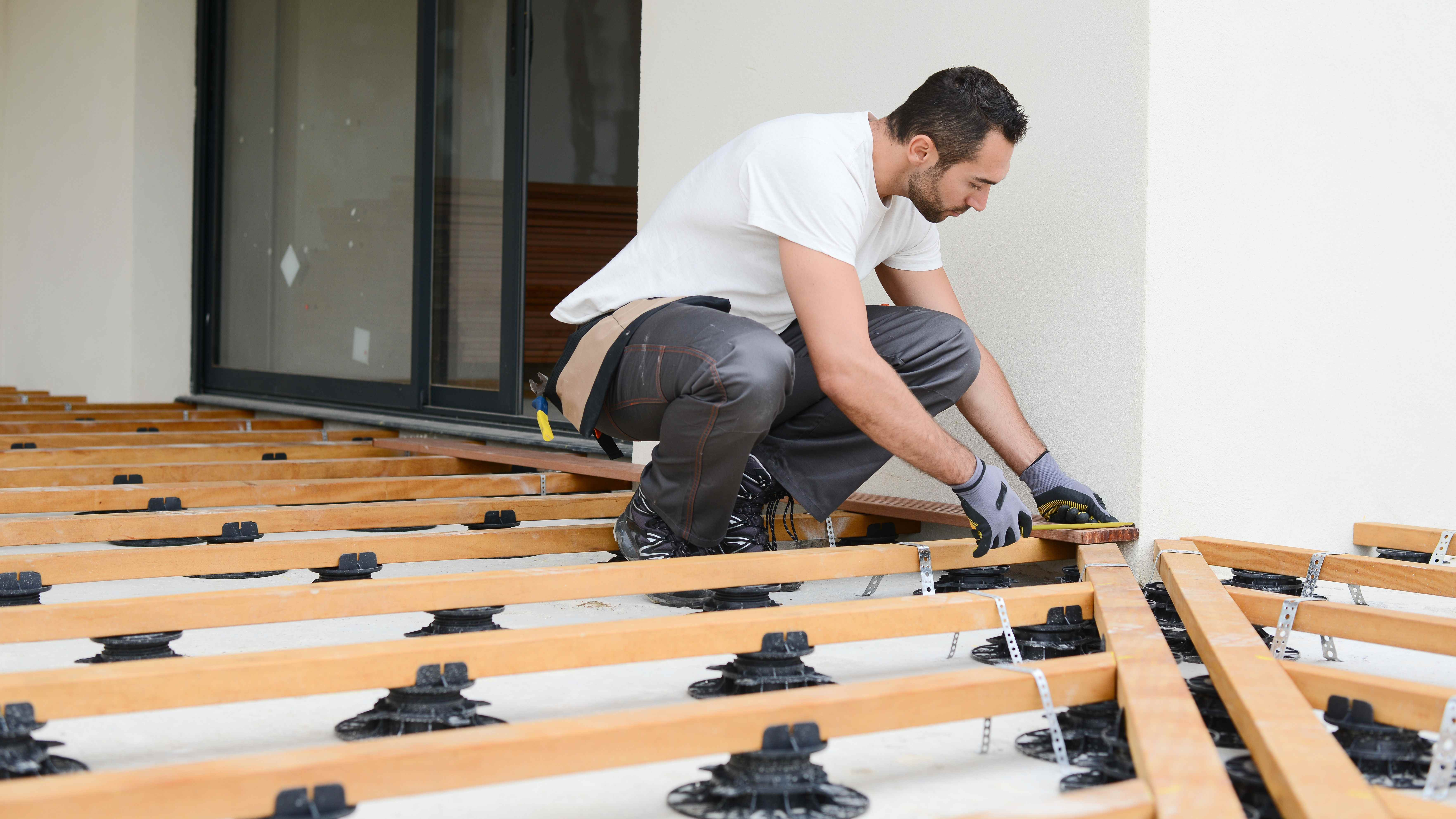 How to lay decking on riser pedestals