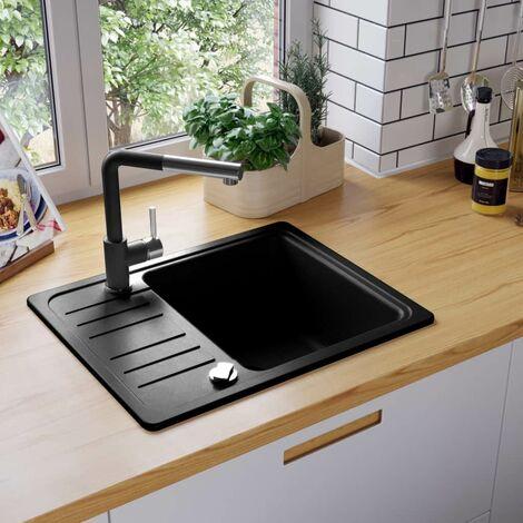 Fregadero de cocina de granito con un seno negro