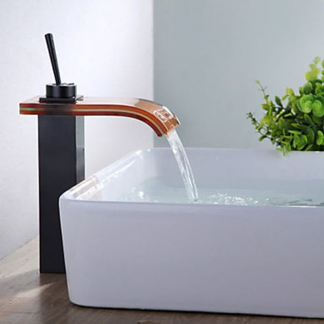 Grifo de lavabo estilo moderno con caño de vidrio curvado teñido de naranja
