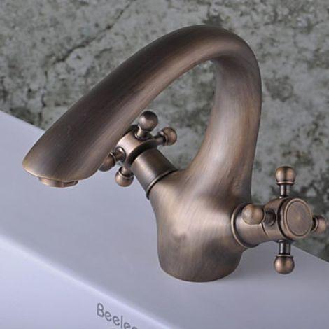 Grifo para lavabo con doble asa acabado en latón para un estilo contemporáneo