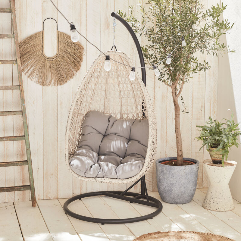 Hanging egg chair in mixed beige rattan with thick light ...
