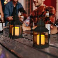Set de cuatro faroles LED de jardín, Vela con efecto de llamas, Iluminación de exterior, Colgante o de pie, 23 cm, Negro