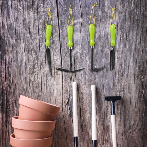 Juego de cuatro herramientas de jardinería