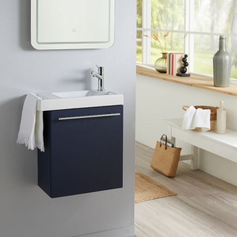 Meuble lave-mains bleu nuit avec lave-mains porte serviettes en céramique et robinetterie eau froide à droite
