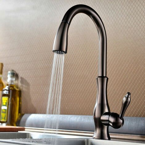 Modern kitchen mixer with hand shower and extractable golden hose