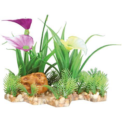 Plante plastique sur lit de gravier