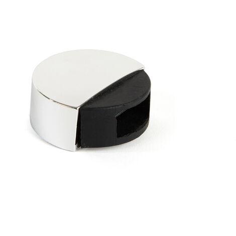 Retenedor de puerta con imán adhesivo marca REI, de estilo moderno, fabricado en cromo brillo y con acabado plástico.