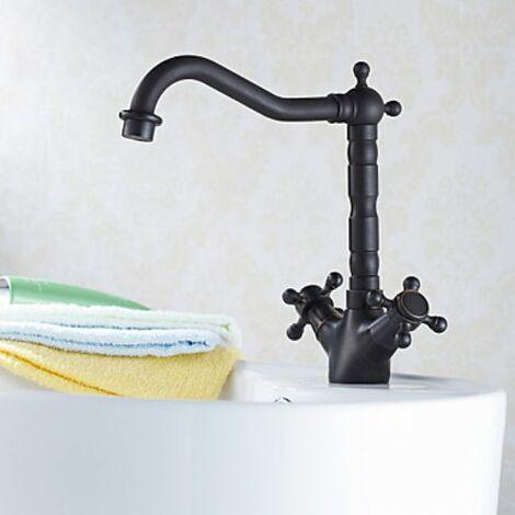 Robinet lavabo style antique muni de deux poignées, finition en bronze huilé