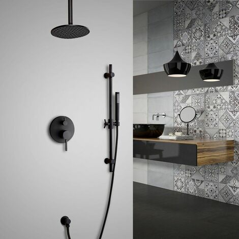 Round thermostatic rain shower system on ceiling