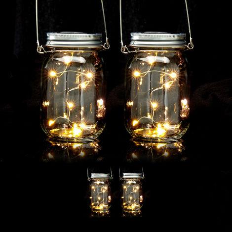 Set de cuatro lámparas solares, 8 LEDs por farol, De pie o colgante, Iluminación para jardín, Transparente
