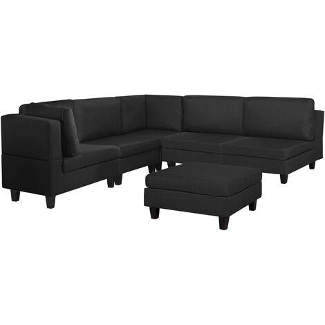 Sofá esquinero tapizado negro con reposapiés FEVIK