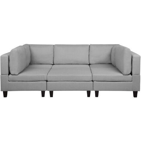 Sofá tapizado gris claro con reposapiés FEVIK