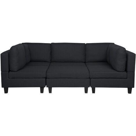 Sofá tapizado negro con reposapiés FEVIK