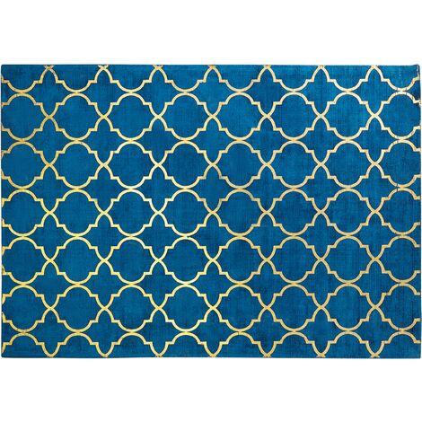 Tapis en soie artificielle bleu foncé avec motif treillis doré