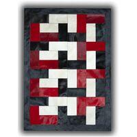 Tapis noir, blanc et rouge sur peau de vache patchwork Ceuta Noir 180x240