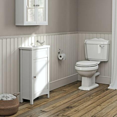 The Bath Co. Camberley complete white cloakroom suite with close coupled toilet, tap and waste