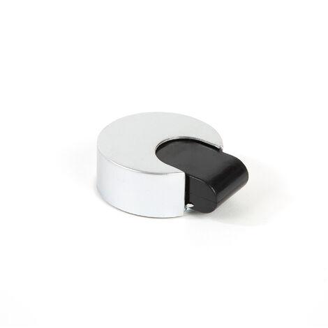 Tope de puerta adhesivo marca REI, de estilo decorativo, fabricado en cromo mate y con acabado plástico.
