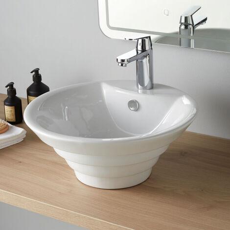 Vasque a poser blanche et ronde en forme de pyramide inversee