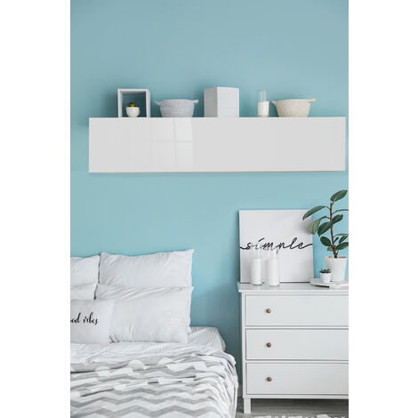 Wall unit with flap structure in cement laminate, glossy white fronts